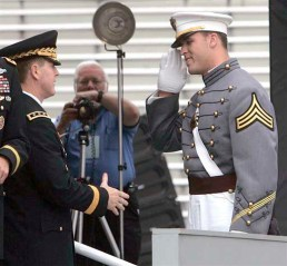 Caleb Campbell, right, who was drafted into the National Football League by the Detriot Lions, salutes as he receives his diploma at the United States Military Academy at West Point, N.Y., Saturday, May 31, 2008.  (AP Photo/Mike Groll)