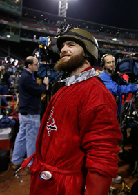 Jonny Gomes wears the helmet while celebrating the Red Sox's ALCS victory. (Charles Krupa/AP)