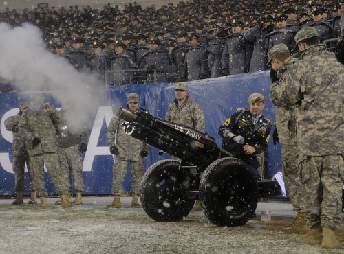 Medal of Honor recipient Sgt. 1st Class Leroy Petry signals the end of the first half of the 114th Army-Navy football game at Lincoln Financial Field in Philadelphia, Pa., on Saturday, December 14, 2013. (Mike Morones/Staff)