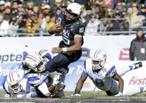 Keenan Reynolds and the Navy Midshipmen will play four games at NFL stadiums this year, including Dec. 13's clash with Army. (USA Today Sports photo by  Tim Heitman)