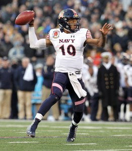 Navy's Keenan Reynolds, here firing a touchdown pass against Army last December, will begin his senior season leading the Mids against Colgate on Sept. 5 in Annapolis. (Staff photo by Jennifer Milbrett)