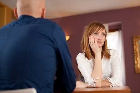 Bad Meeting: Bored Woman Can't Listen to Blowhard Talking