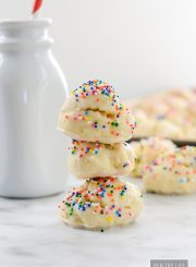 Annisette Italian Cookie Recipe delicate cake like cookies glazed and topped with sprinkles | ahealthylifeforme.com