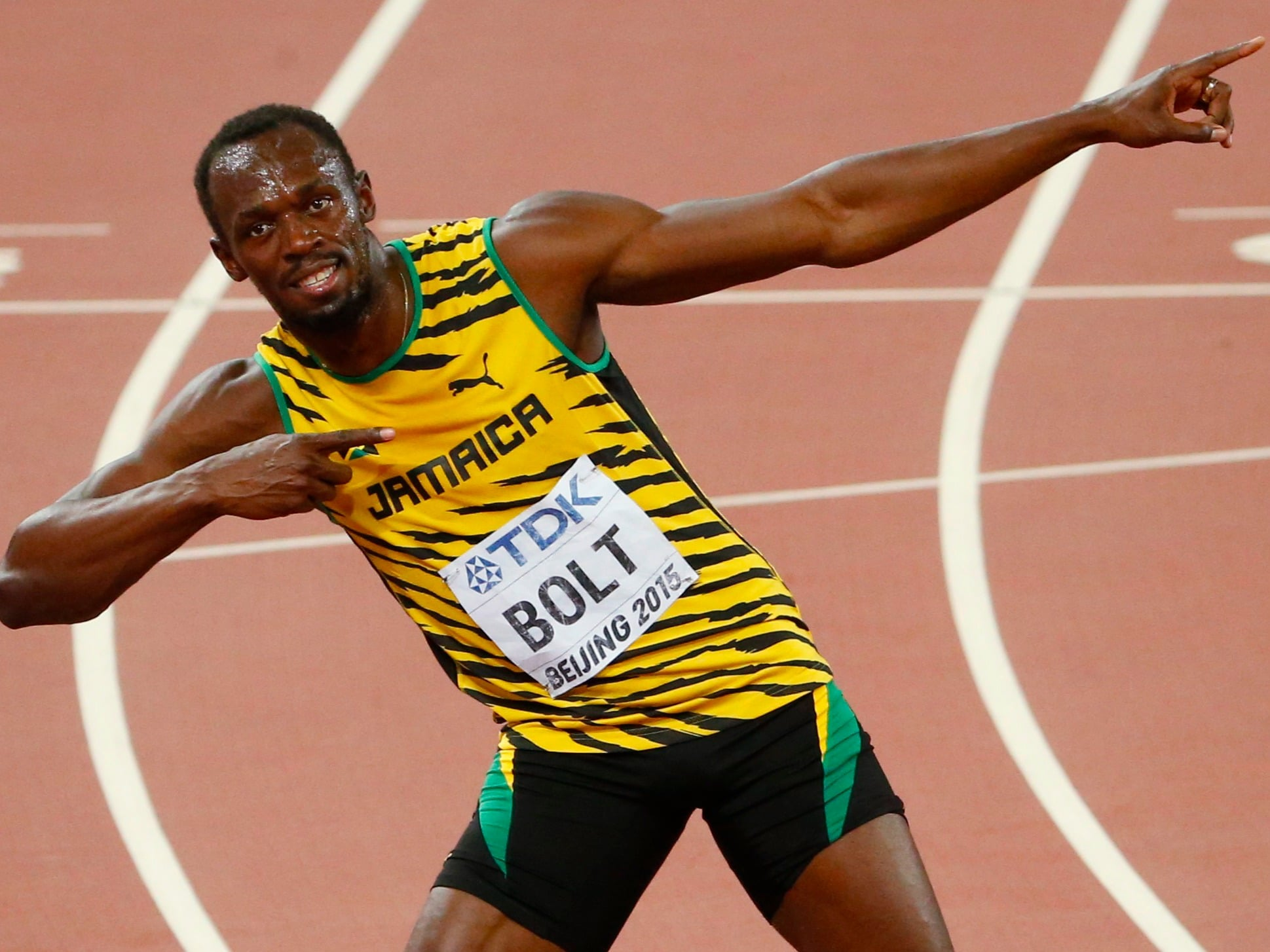 Usain Bolt 100m Olympic Victory go into his famous Lighting Bolt pose.