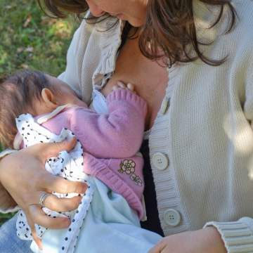 exclusive breastfeeding: mother breastfeeding young baby