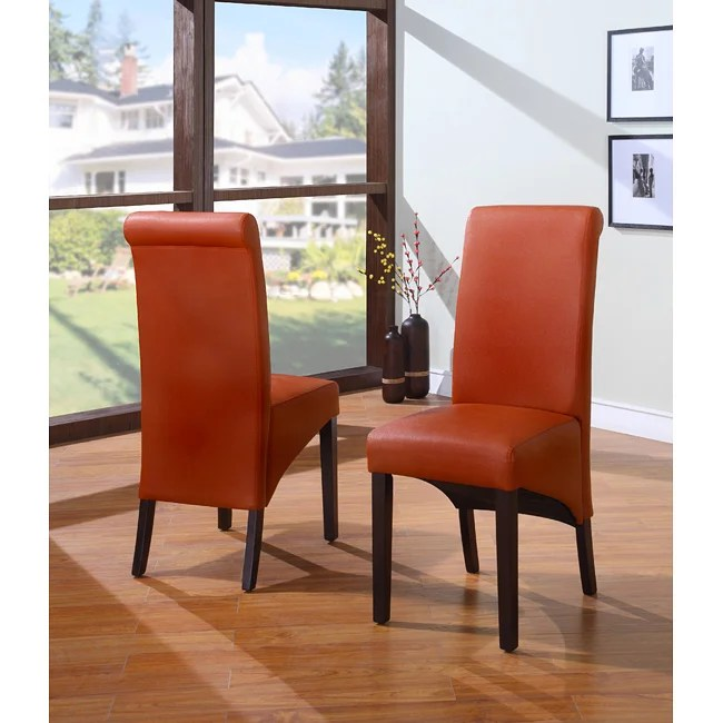 These Parson dining chairs highlight a button tufted and copper
