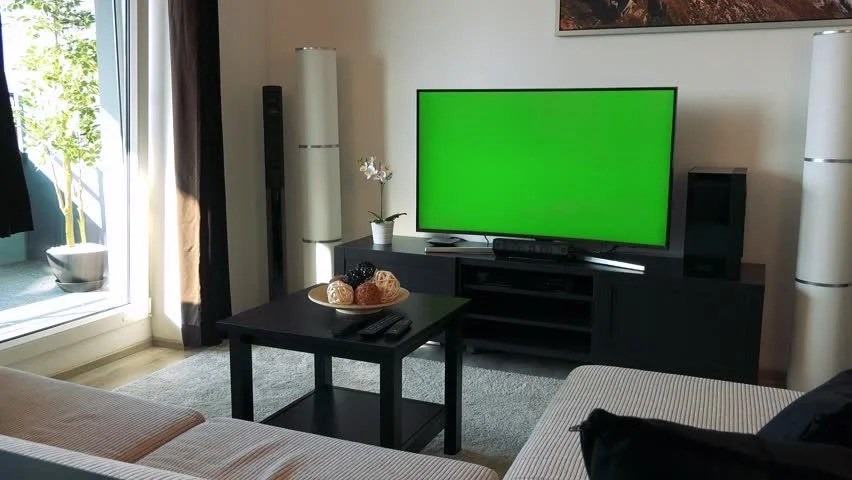 Young Woman Watches Green Screened TV In Living Room, Dolly Shot - tv in living room