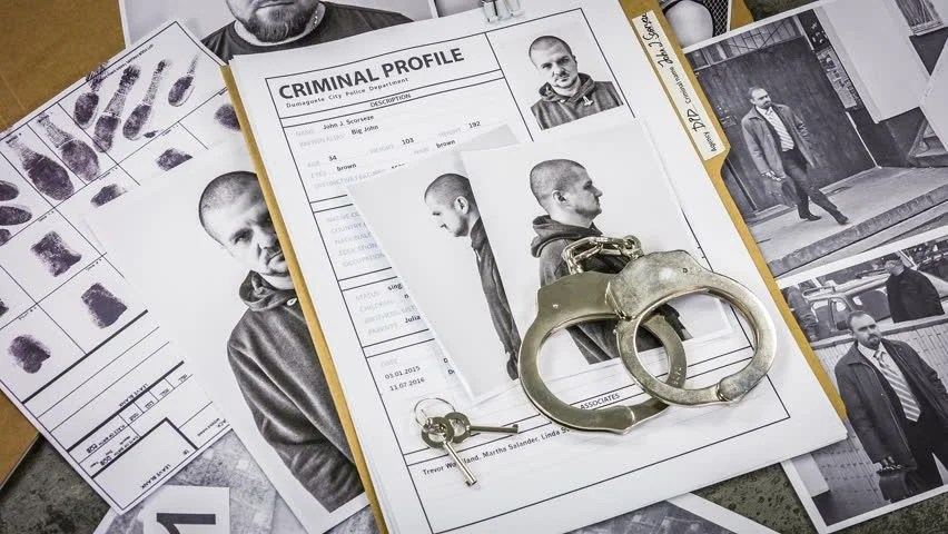 Stock video of criminal cases in a folder, faces 30144421