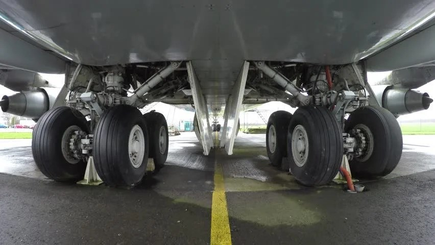 Aeroplane Fly Close Up Of Main Landing Gear Undercarriage Under Fuselage