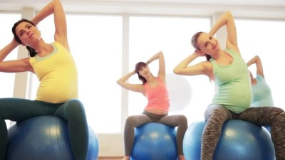 Exercise Class Doing Sit Ups On Exercise Balls At The Gym ...