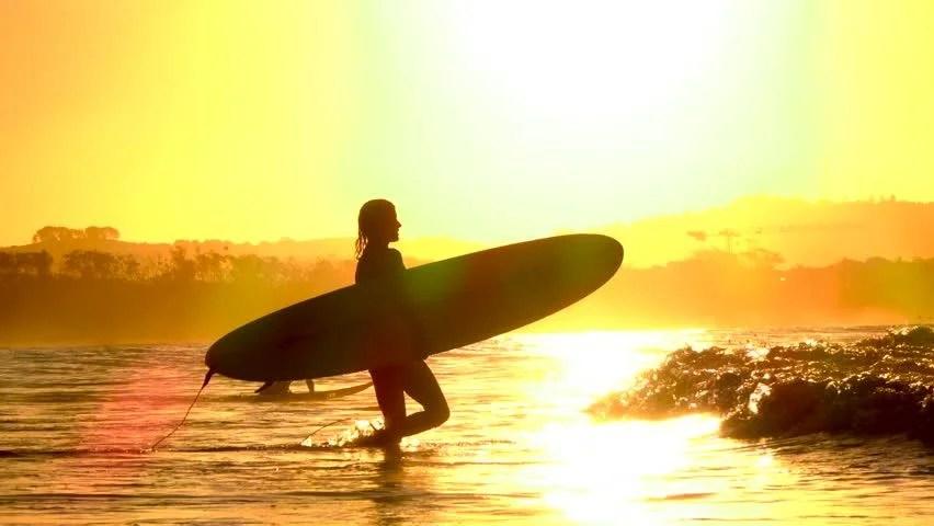 Surfer Girl Bali Wallpaper Silhouette Surfer Girl Walking On Beach At Sunset In Slow