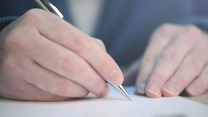 Businessman Writing Application Form Stock Footage Video 1261978 - writing contract agreements