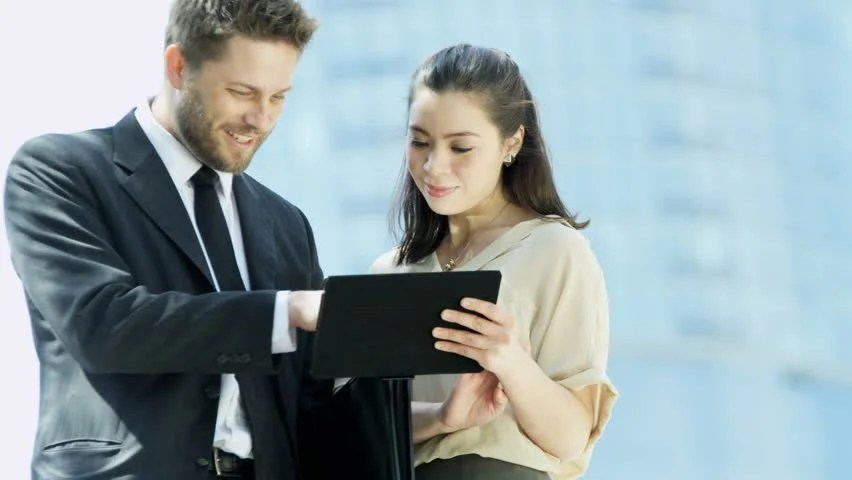 Stock video of business executives meeting outdoors - young - business tablet