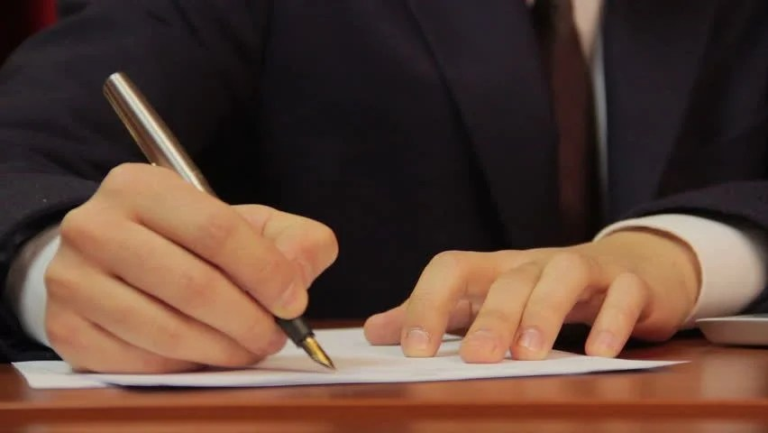 Businessman Signs Papers, Contract, Agreement, Works On Laptop - writing contract agreements