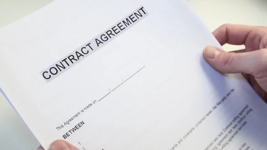Man With A Blank Contract Agreement Form In Hands A Contract Is A - writing contract agreements
