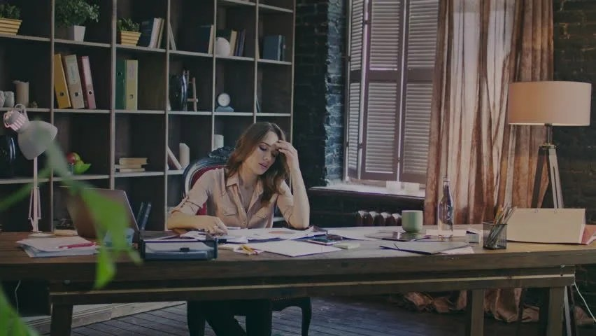 Concentrated Businesswoman Sitting at Table Stock Footage Video (100