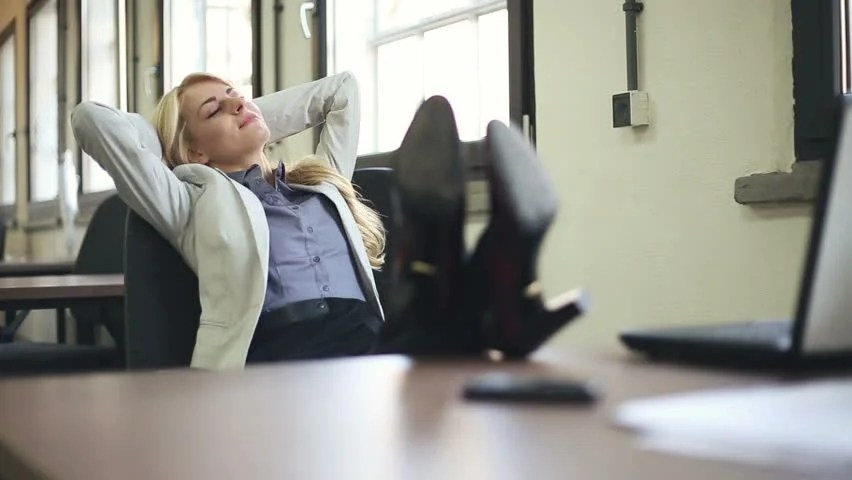 Businesswoman Finishing Work and Relaxing Stock Footage Video (100