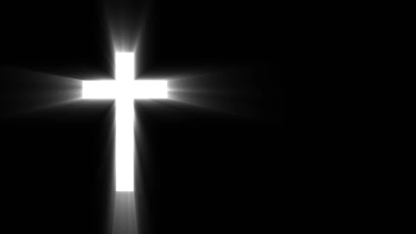 hd0020Christian cross with sun rays shine on the dark background