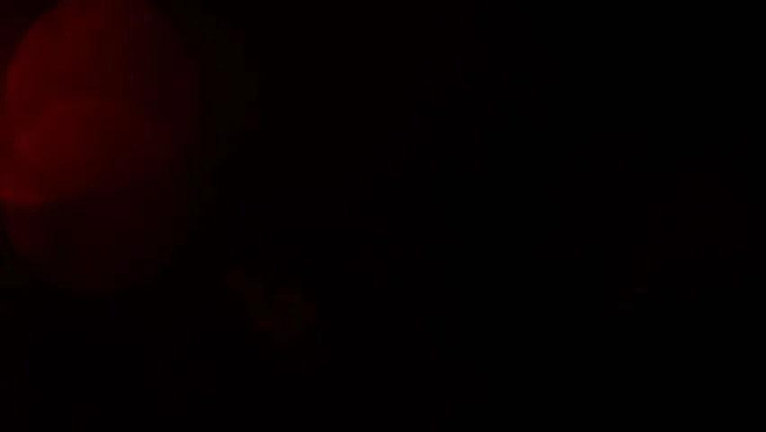 hd0008Moving red defocused lights through dark background
