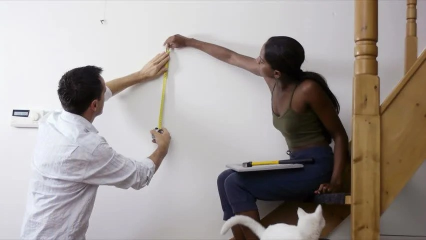 Height To Hang Pictures Diy, Multiethnic Couple Hanging Pictures To The Wall And