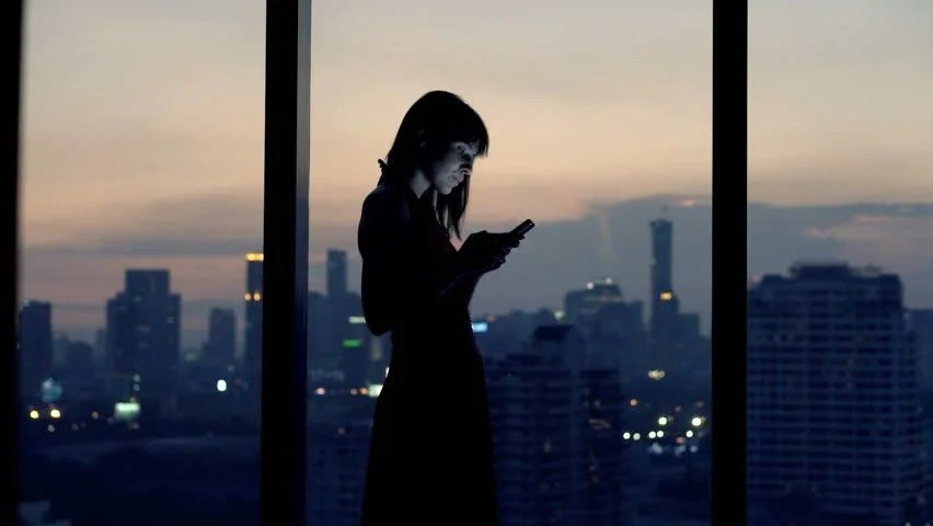 Lonely Girl Walking Wallpaper Young Woman Looking At Cityscape By The Window At Night