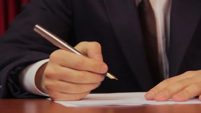 Businessman Signing A Contract, Agreement, Working In Office Stock - writing contract agreements