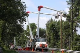 Alabama Power crews working to repair poles and cables at Sanders Road in Bluff Park in Hoover, AL.