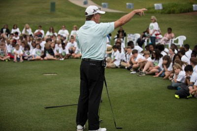 Pro golfers teach golf, life lessons at Junior Clinic ...