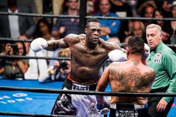 Deontay Wilder (white trunks) defeated Chris Arreloa (black trunks) after eight rounds with a technical knockout. (Nik Layman)