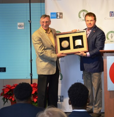 """Reeves Sims, left, receives the """"Volunteer of the Year"""" award for the PGA Tour Champions from Bruno Event Team CEO Gene Hallman. (Michael Tomberlin / Alabama NewsCenter)"""