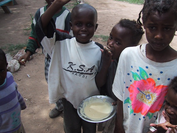 Orphans eating with their hands in Hargeisa.