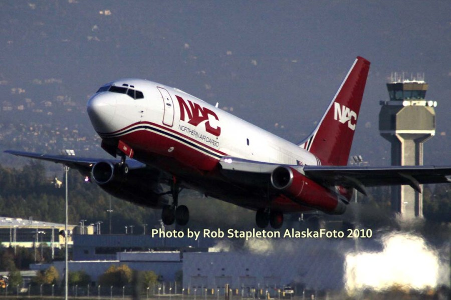 A Nothern Air Cargo Boeing 737-200 lifts off from Ted Stevens Anchorage International Airport. Photo by Rob Stapleton/Alaskafoto