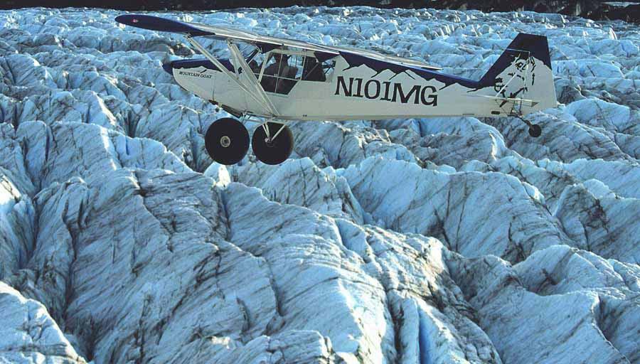 KNIK GLACIER-The Mountain Goat aircraft built by Bill Montagne in flight  over the Knik Glacier near Anchorage. Photo Rob Stapleton/ Alaskafoto 2005