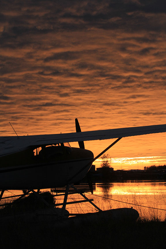 Sunset behind a floatplane at PALH