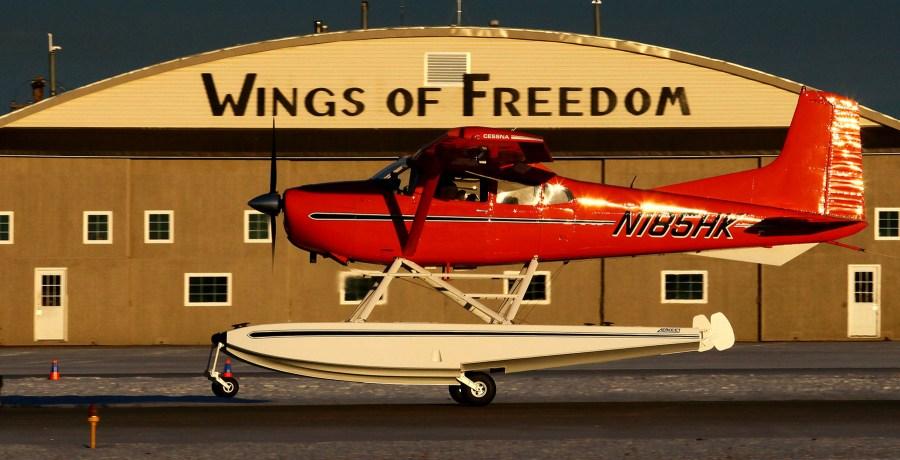 Cessna 185 lifting off from runway 25 at PAMR