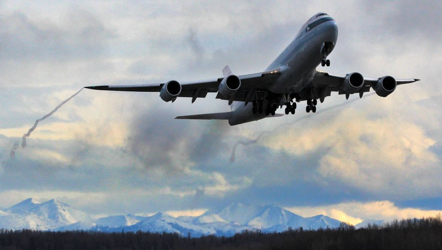 Boeing 747 800 climbing out of Ted Stevens Anchorage International Airport. Photo by Rob Stapleton