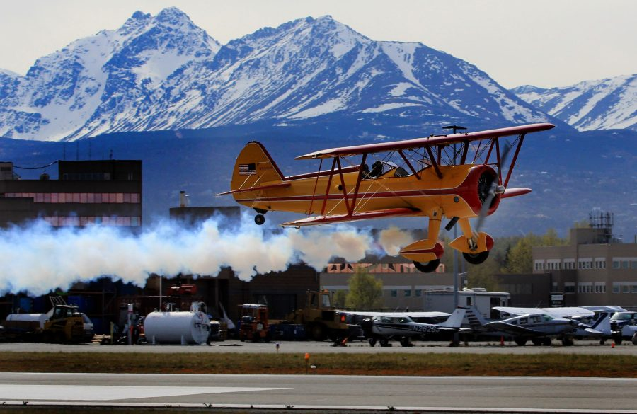 Marcus Paine takes off from Merrill Field  in his Stearman biplane on a practice run for the Valdez Fly-In and Airshow coming up this weekend in Valdez on May 8-10. tune into  Channell 4 Anchorage or ABC on Thursday night for a full report. Photo by Rob Stapleton/Alaskafoto