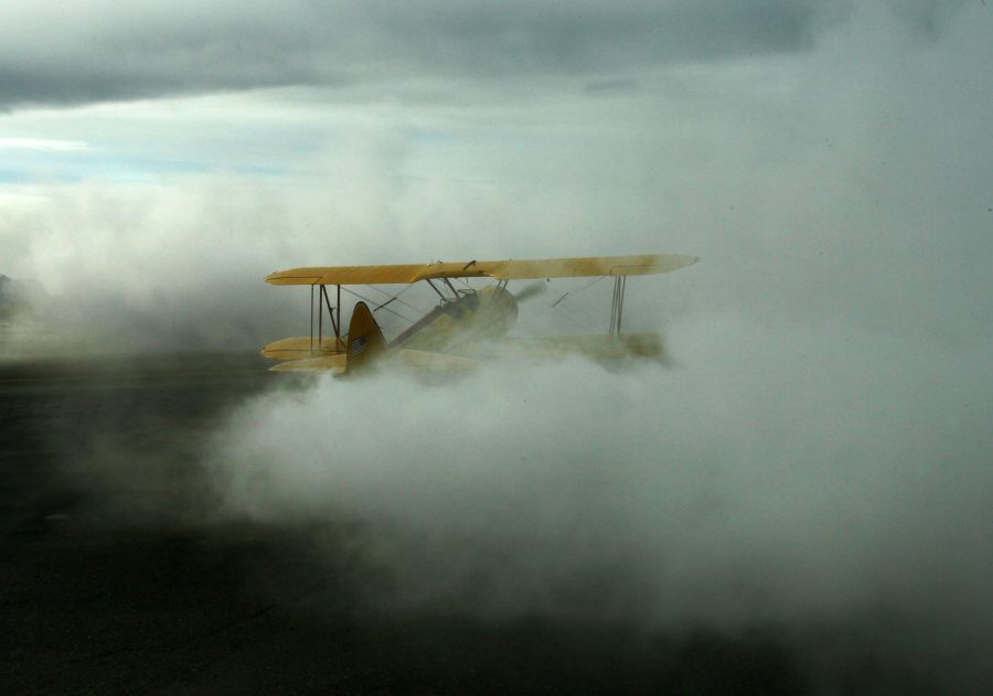 Stearman blowing smoke, for the Valdez Fly-In and Airshow