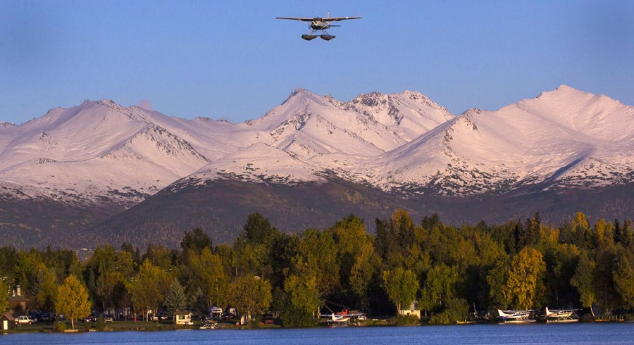 Cessna on floats over the Chugach mountains of Alaska. by Rob Stapleton