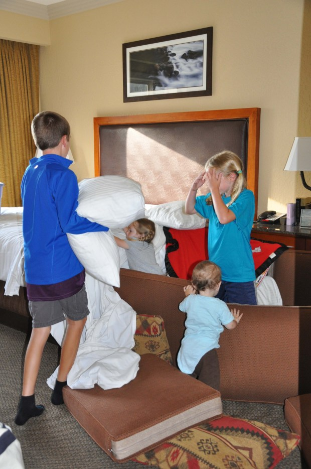 Older kids showing them how it's done: forts, slides, walls made out of pillows.