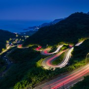 The cars light up Jinshui road as they wind down the mountain in Taiwan.