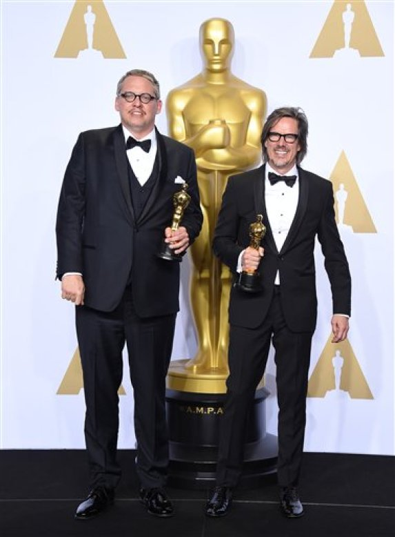 "Adam McKay, left, and Charles Randolph pose with the award for best adapted screenplay for ""The Big Short"" in the press room at the Oscars on Sunday, Feb. 28, 2016, at the Dolby Theatre in Los Angeles. (Photo by Jordan Strauss/Invision/AP)"