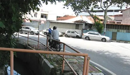 motorcyclist on a pedestrian walkway