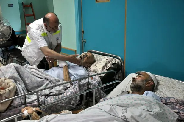 Dr Basman Alashi, caring for patients needing critical care at al-Wafa hospital, had to evacuate his patients after Israel bombed the hospital several times. - Photograph: Mohammed Talatene / APA images