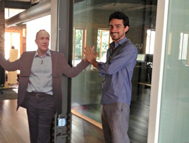 Locu CEO Rene Reinsberg poses with a cardboard cutout of his idol, Tim Berners-Lee, at the Locu office