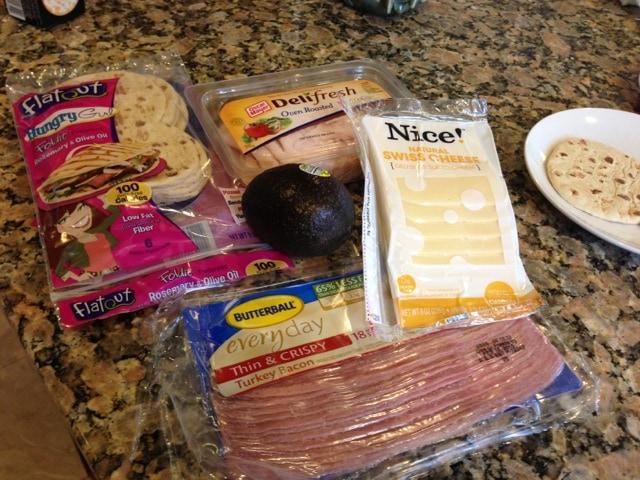 thinly slice deli turkey sliced swiss cheese turkey bacon avocado