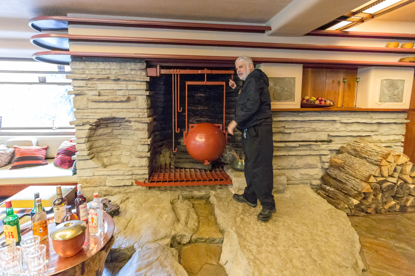 Ken standing on the boulder hearth