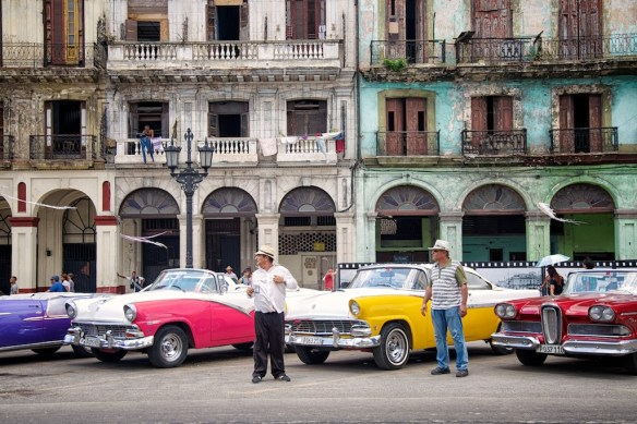 Cab drivers with classic cars in Havana