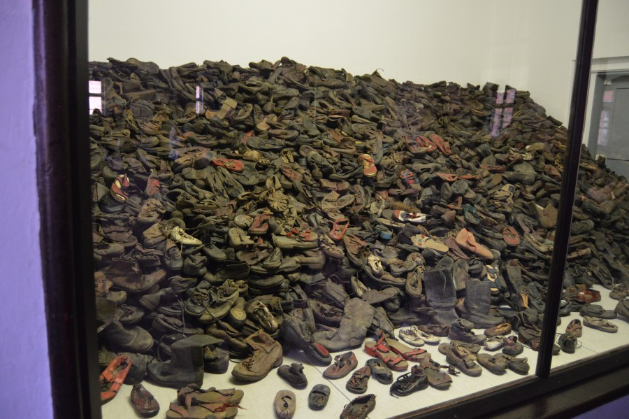 A portion of the shoes seized from the prisoners.  This collection is exclusively children's shoes.