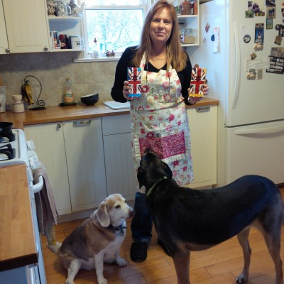 Here I am, with our two dogs Cocoa and Bear,  holding the chocolate bars and wearing my new Apron.